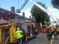 Dudley Road closed as 15 firefighters tackle Tipton roof blaze