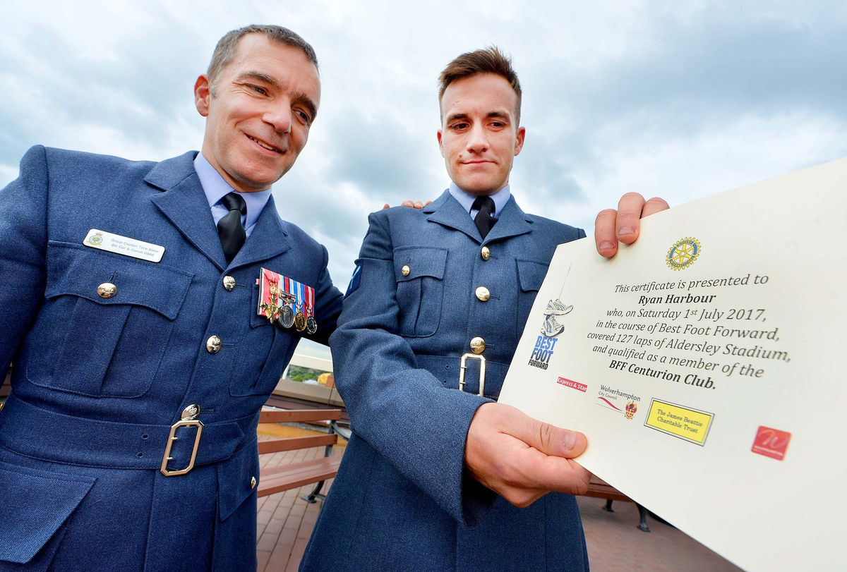 Group Captain Tone Baker presented Ryan Harbour with his certificate
