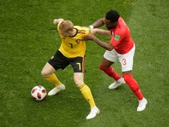 Why did Danny Rose wear socks full of holes against Belgium?