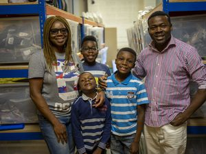 Adewumi Akinyotu, owner of Fashion Flair, with her family
