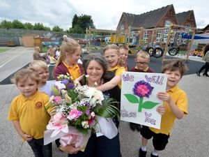 Sharon Kelly, with pupils during a picnic in the playground, at Leamore Primary School, Walsall