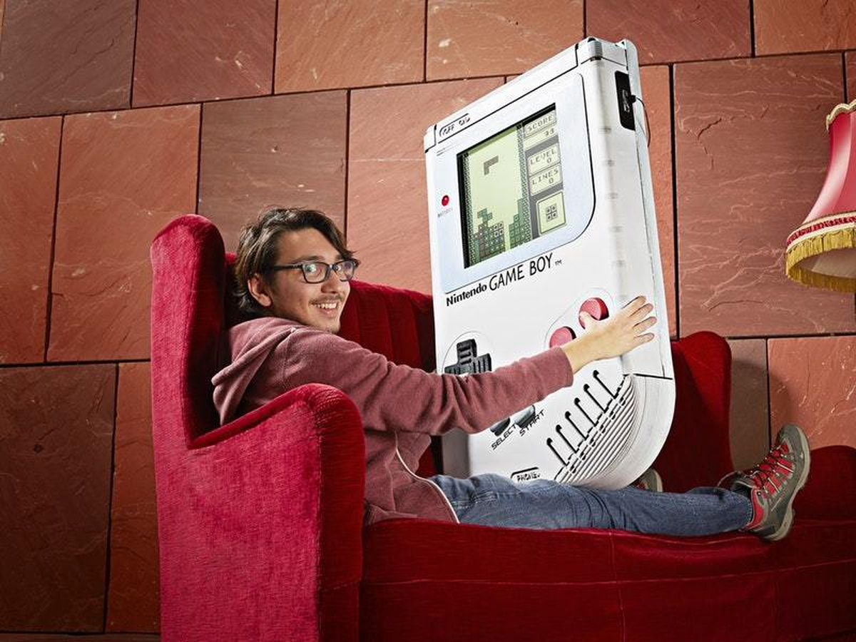 Ilhan Unal with his massive Game Boy – (Ranald Mackechnie/Guinness World Records)