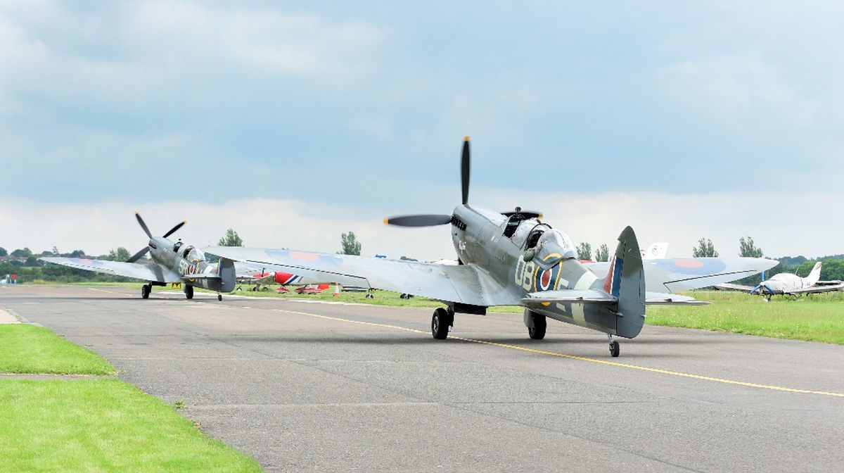 The two Spitfires on the commemoration flight prepare to take off.