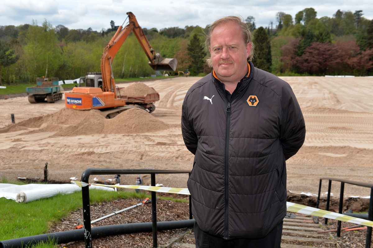 Wayne Lumbard watches as pitches are laid at the training base