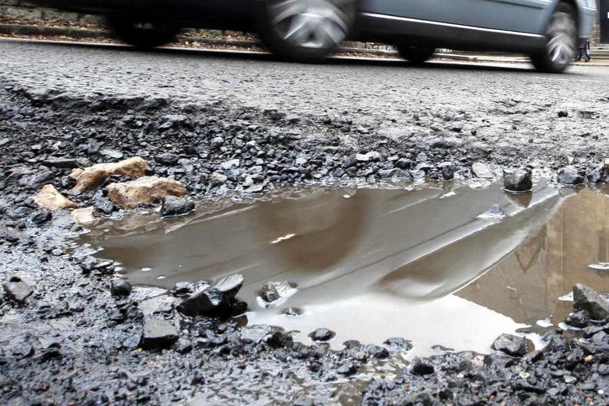 A stock photo of a pothole