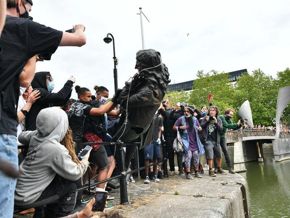 The statue of Edward Colston is thrown into Bristol harbour