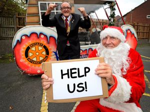 SANDWELL COPYRIGHT EXPRESS&STAR TIM THURSFIELD-04/11/20.Malcolm Johnson dressed as Santa, and Rotary Club of Wednesbury president John Stockall appeal for presents to hand out this year, as they are unable to do this years Father Christmas float project due to Covid restrictions...