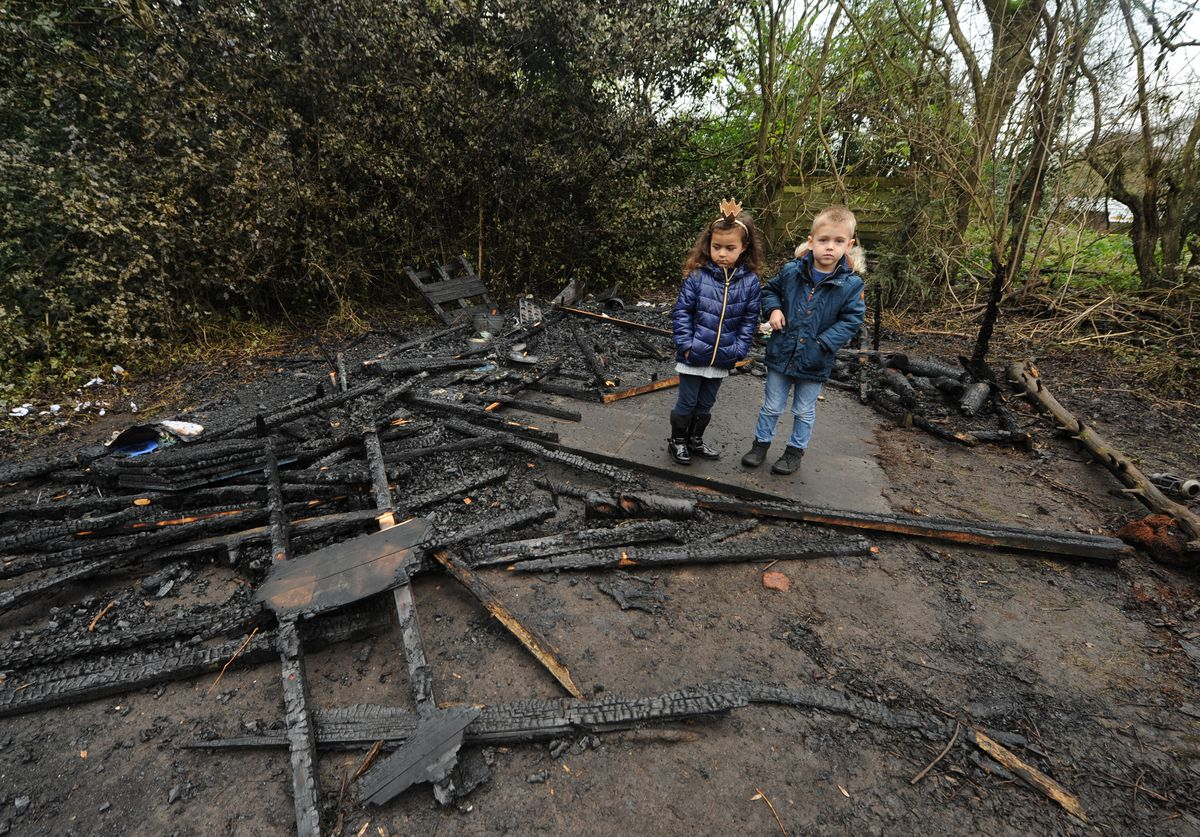 Essence, aged five, and Daniel, age four, in the burnt down forest school