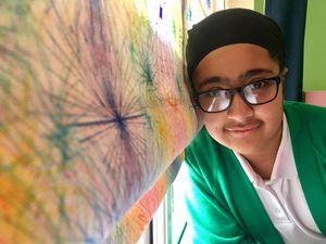 Pupil scoops prize for winning blind design
