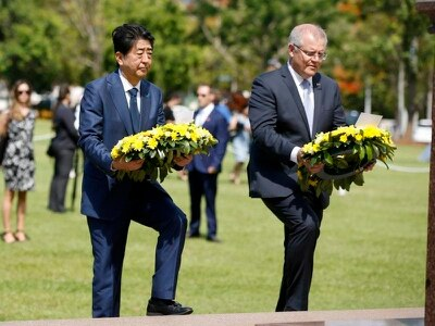 Japanese PM Abe lays wreath in Australia city bombed in WWII
