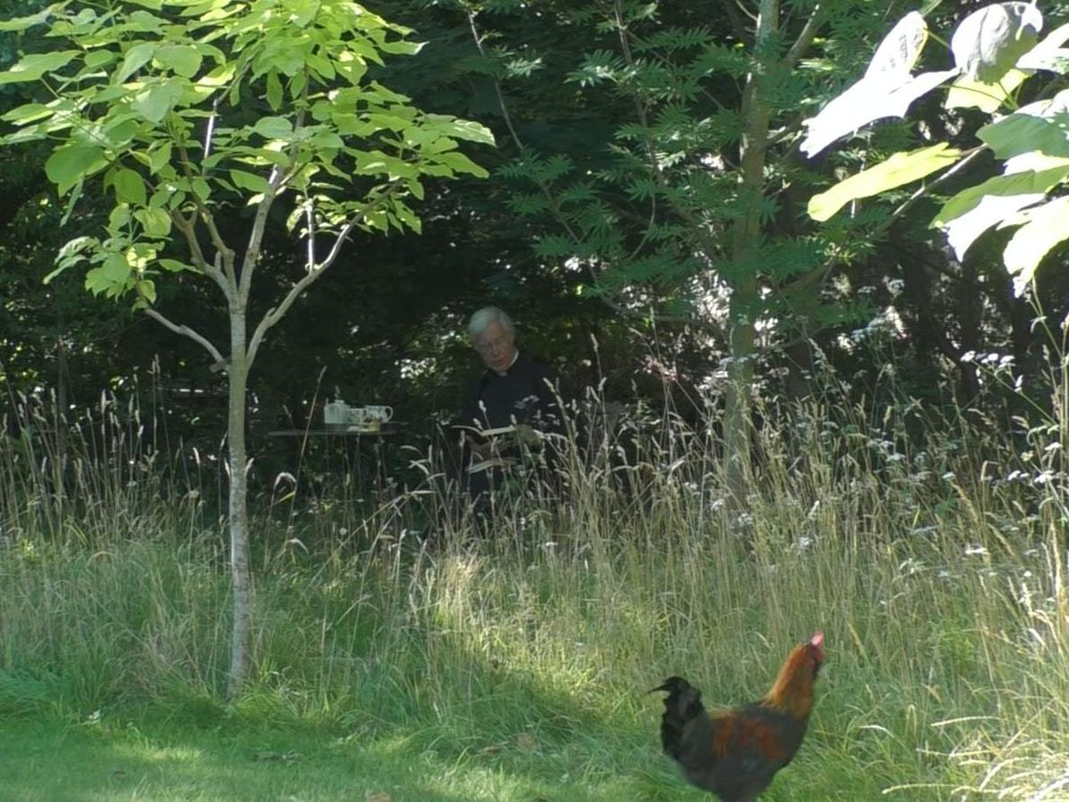 Dean of Canterbury the Very Revd Dr Robert Willis with Russell Crow the rooster