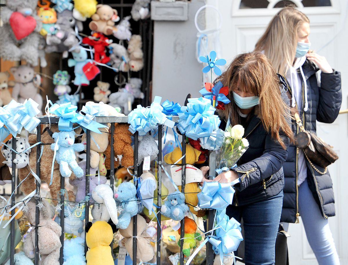 Soft toys and flowers on Brownhills High Street in memory of baby Ciaran Morris