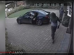 CCTV released after masked robbers raid home