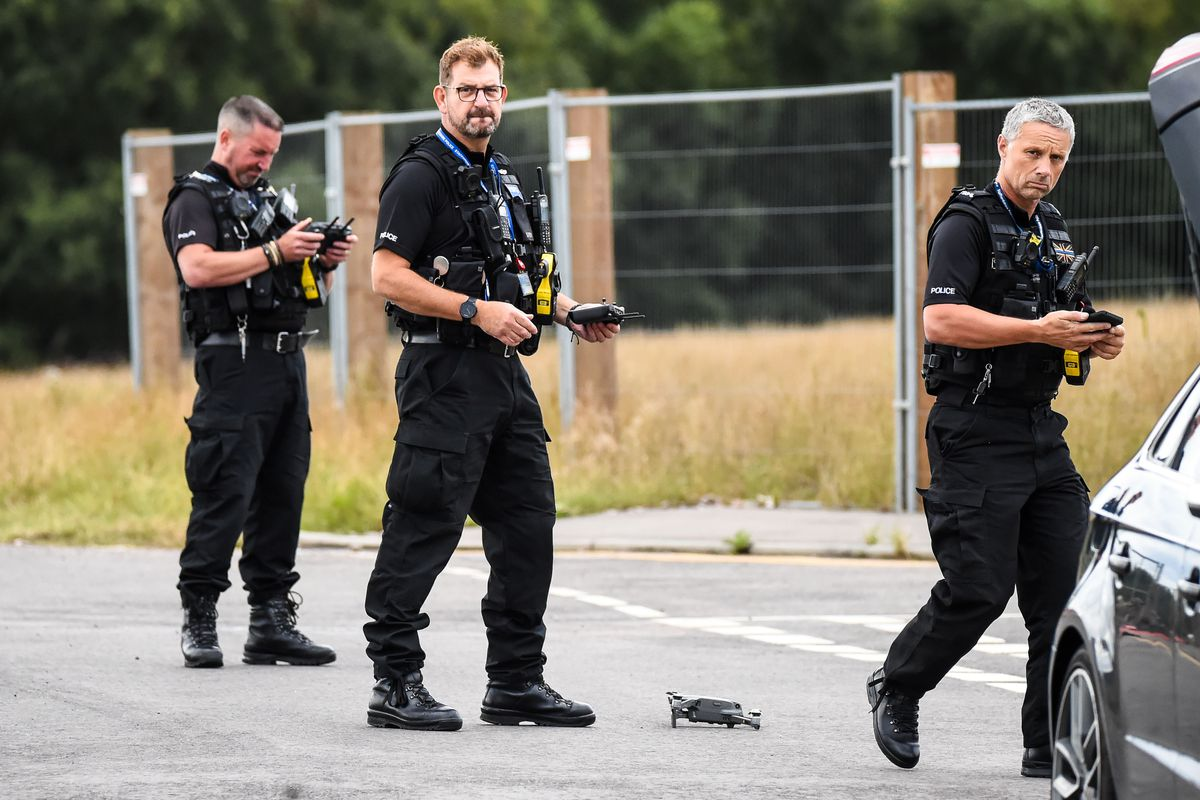 Police deploying a drone at the scene. Photo: Snapper SK