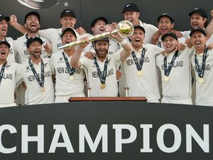 New Zealand captain Kane Williamson lifts the trophy