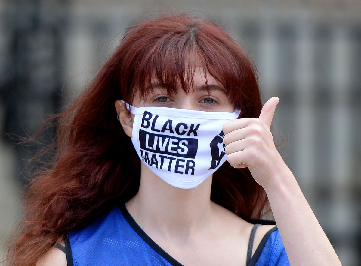 Many protestors wore face masks in solidarity with BLM