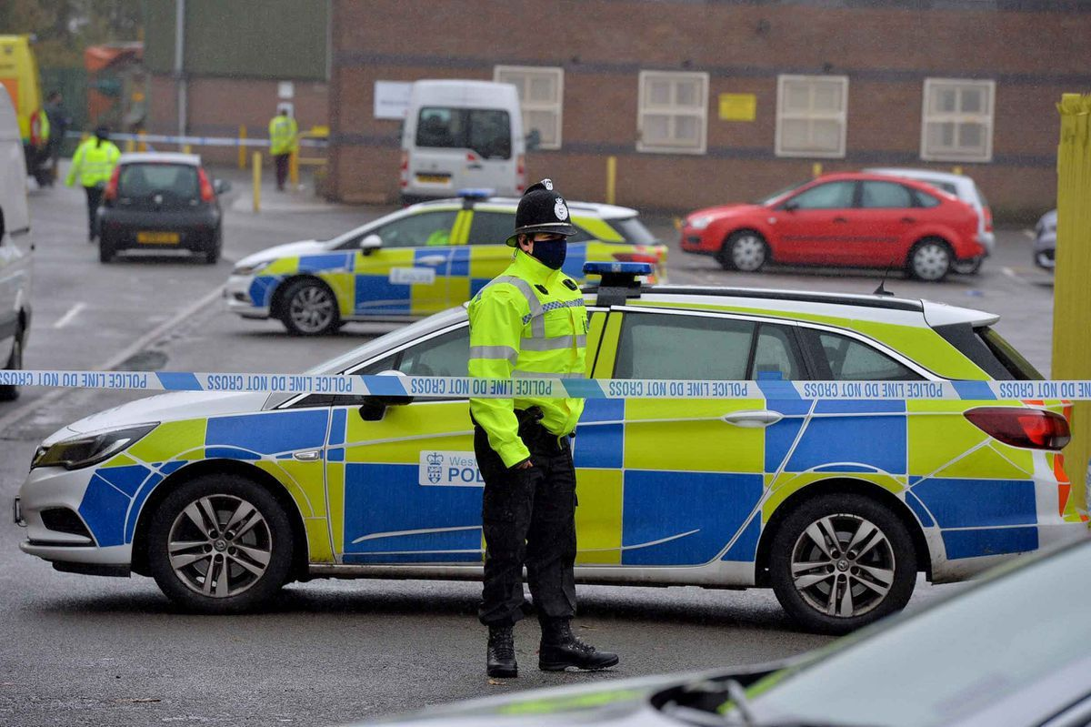 Police at the scene of the murder in October