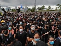 Protesters demand resignation of embattled Hong Kong leader