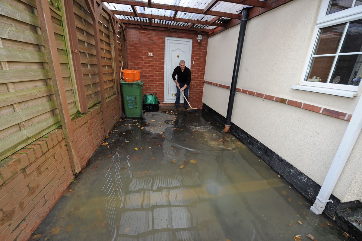 Unhappy sewage water is flooding outside his home for the past two weeks, Paul Cheadle, of Coseley