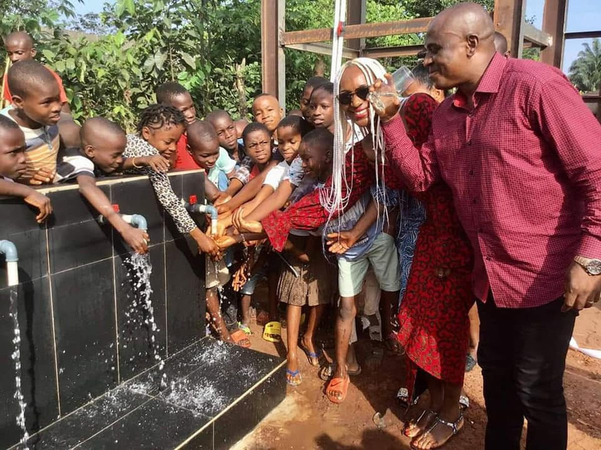 Councillor Hibbert at the commissioning of a water project for a rural community, donated by Imo diasporan Festus Mbisiogu (right)