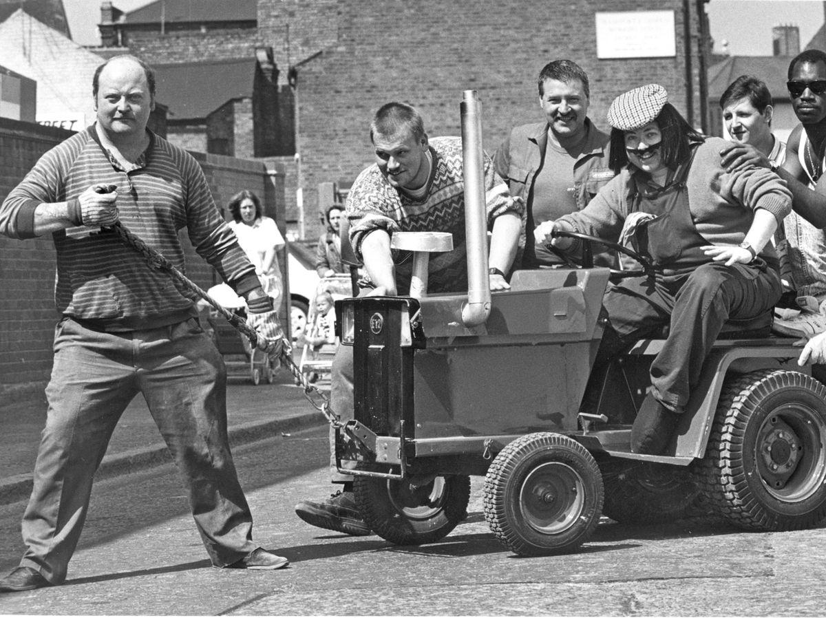 Builders help Postman Pat character Ted Glen on his way