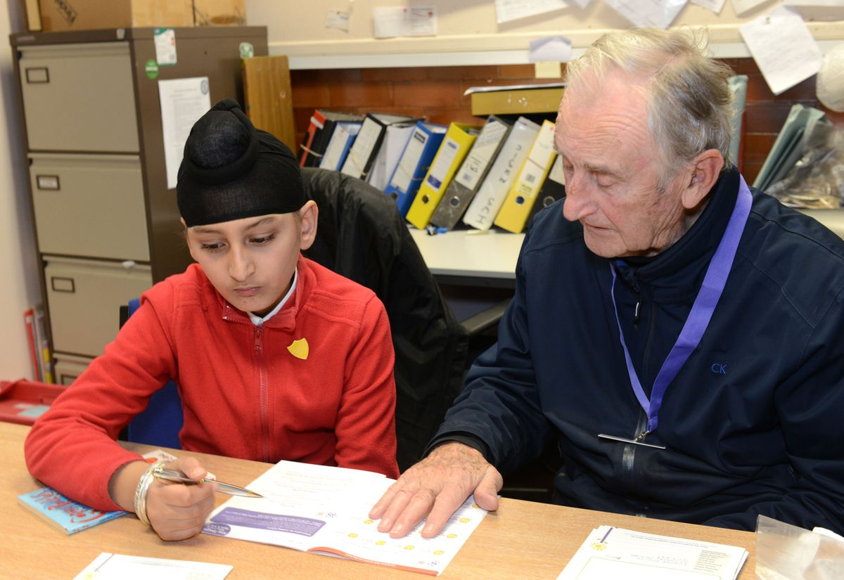 Ted Dexter volunteered to help pupils at Graiseley Primary School with their reading