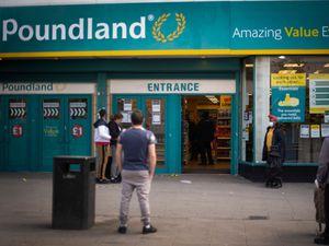 People queue to enter a Poundland shop