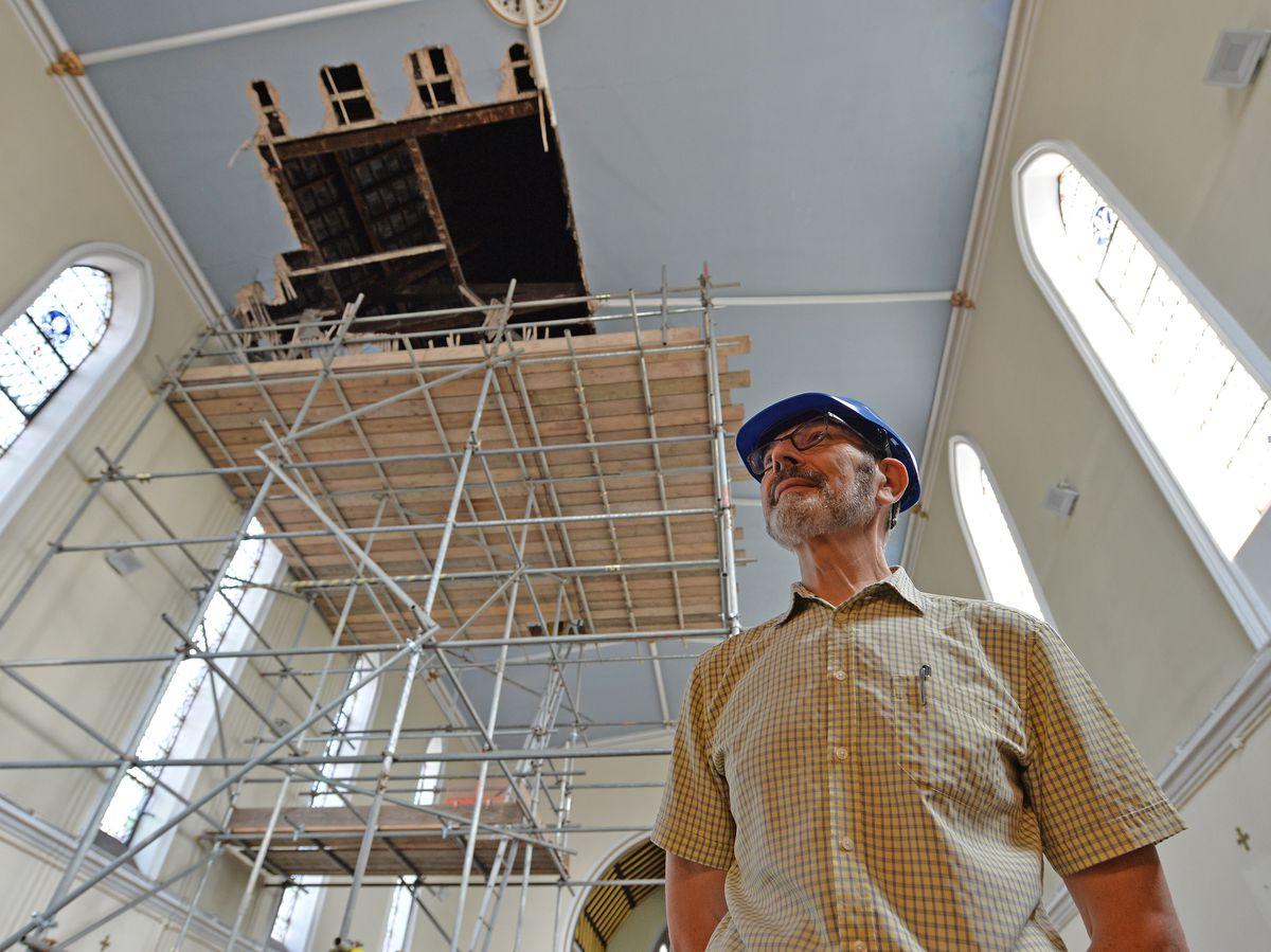 Caretaker Philip Croot inside Holy Trinity, Bilston