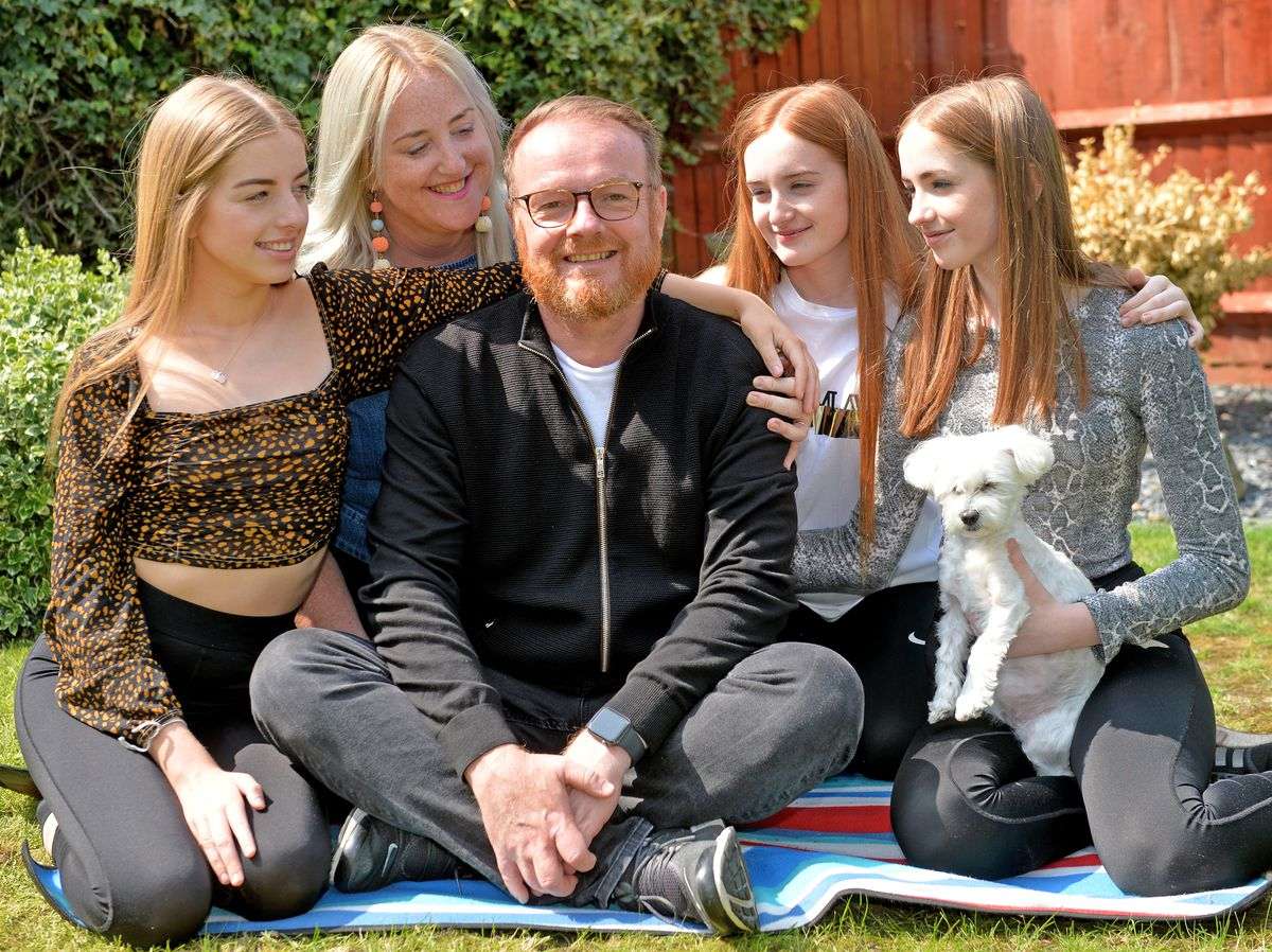 Darren Buttrick, from Coven near Wolverhampton, with his family