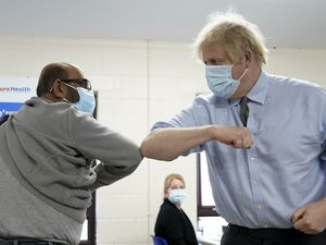 Prime Minister Boris Johnson elbow bumps Ismail Patel after getting his jab