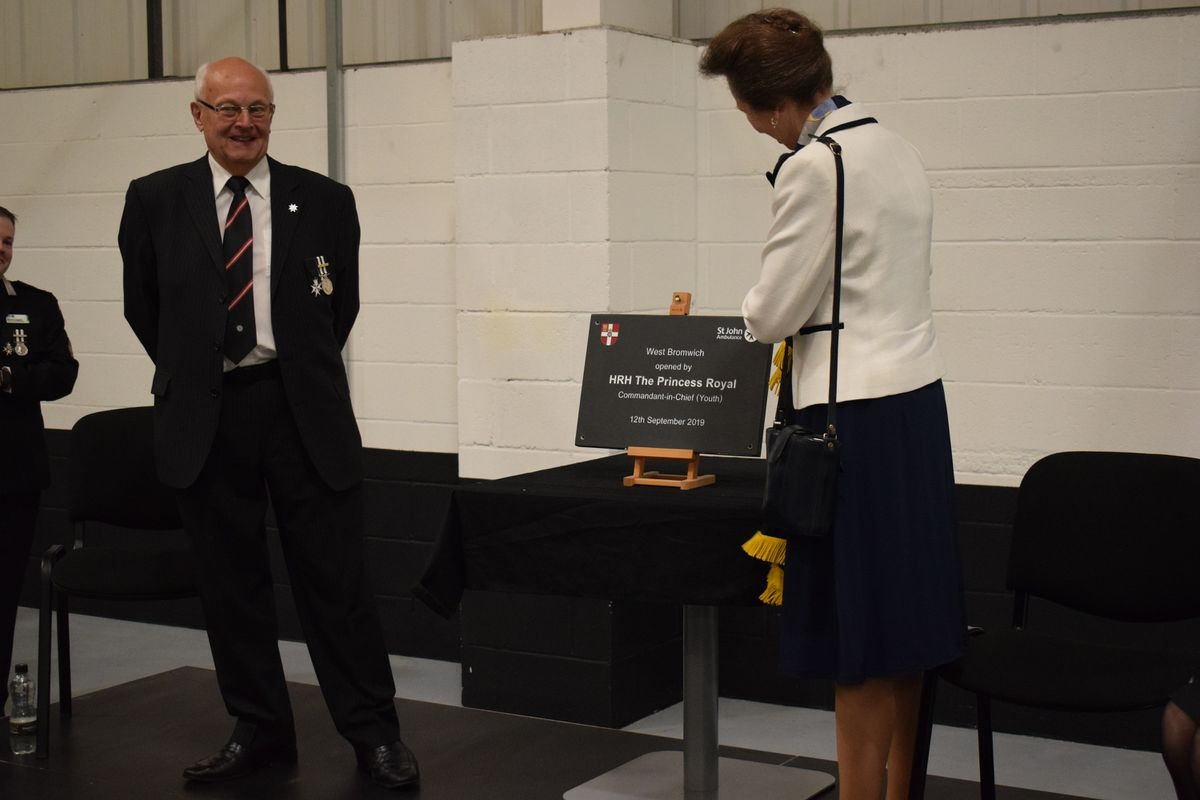 HRH The Princess Royal unveils a plaque to mark the opening of St John Ambulance's West Bromwich operations and training hub, flanked by CPG chairman Keith Hunter.