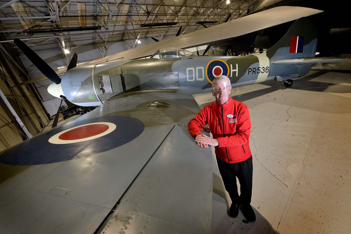 Visitor experience assistant Martin Hill, from Claverley, with the new arrival now on display at the RAF Cosford Museum
