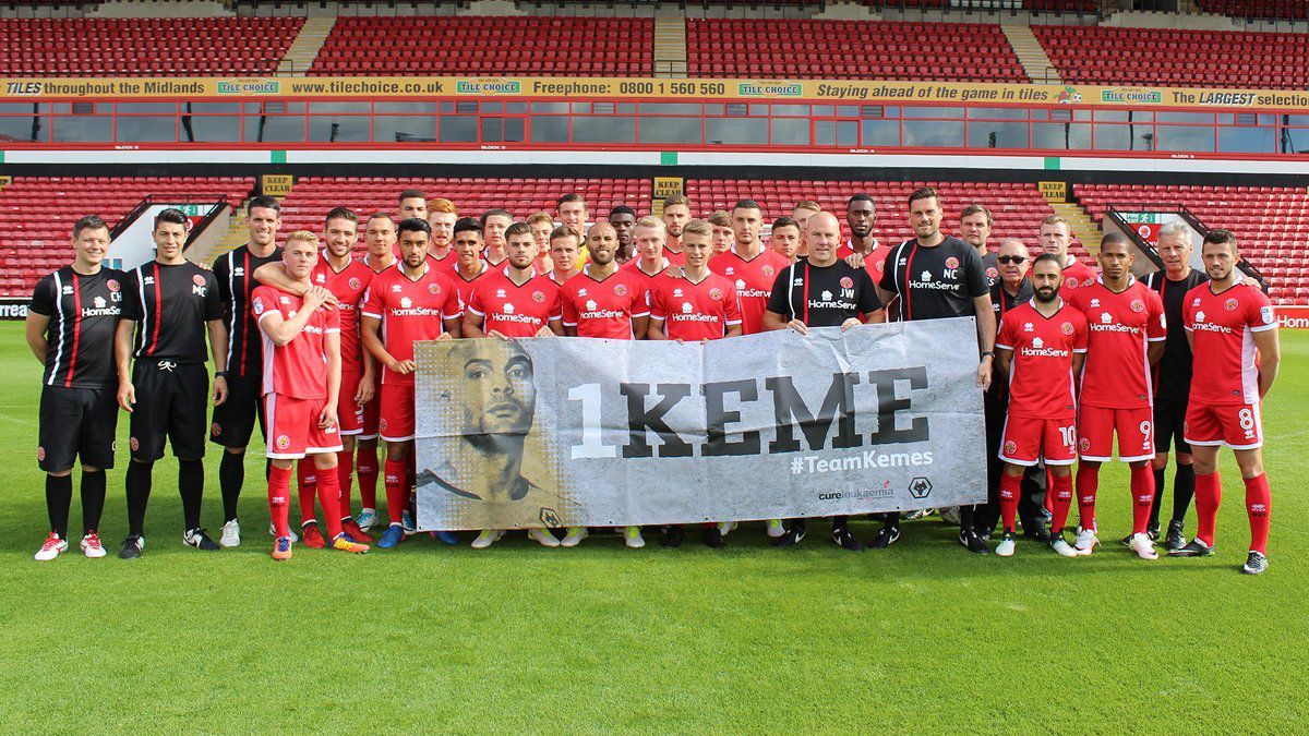Walsall's first team squad hold up an Ikeme banner