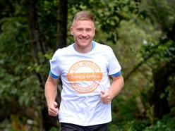 Modest James battles elements to run 90 miles in 24 hours for Acorns Hospice