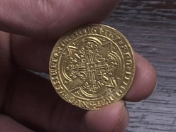 Auctioneer strikes gold with ancient coin hidden in secret drawer