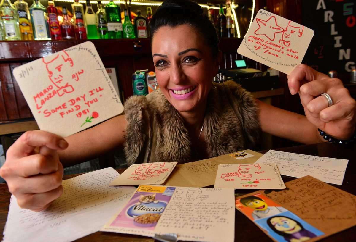 Sara Harvey with some of the cards at The Wheatsheaf pub