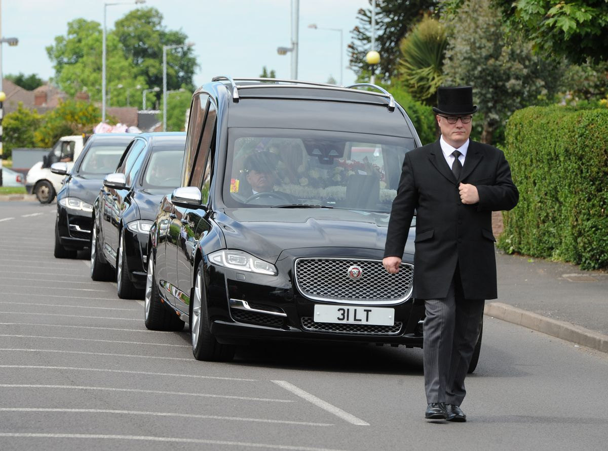 The procession is led through Merry Hill towards St Michael's Roman Catholic Church on Coalway Road in Wolverhampton