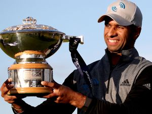 England's Aaron Rai celebrates with the trophy after winning the fourth round of the Aberdeen Standard Investments Scottish Open at The Renaissance Club, North Berwick. PA Photo. Picture date: Sunday October 4, 2020. See PA story GOLF Scottish. Photo credit should read: Jane Barlow/PA Wire. RESTRICTIONS: Use subject to restrictions. Editorial use only, no commercial use.