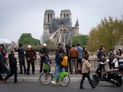 Notre Dame Cathedral fire 'fully extinguished'