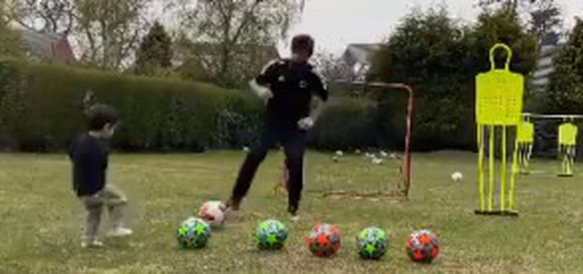 Ruben Neves training with his son, Martim, in the back garden while having to self-isolate