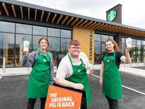 Georgina Mason, left, Harvey Hammond and Mollie Rogers waiting to take orders at the new Starbucks drive thru