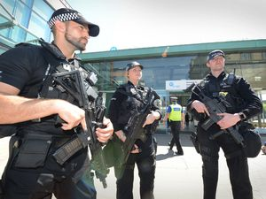 Could armed police officers, such as these outside Wolverhampton bus station following the Manchester terror attack, become a regular sight?