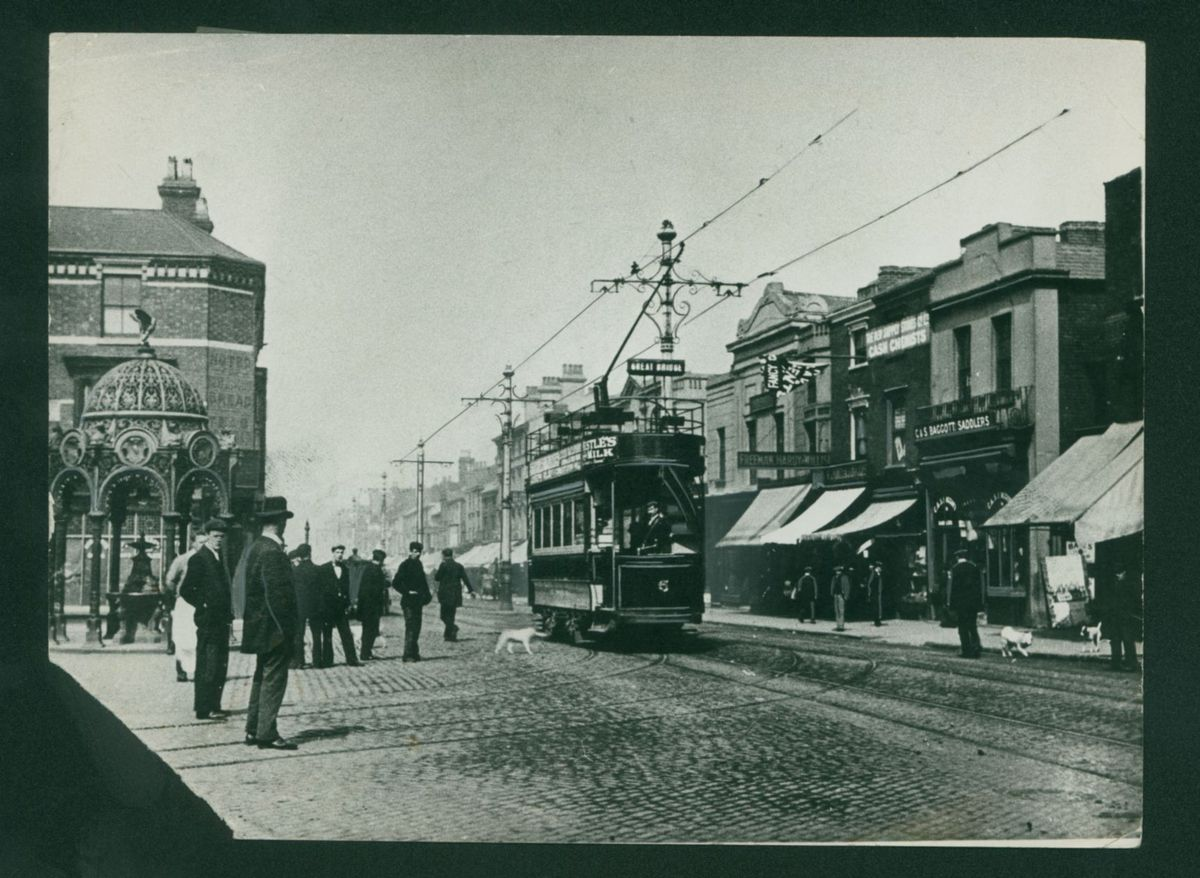 A tram on the high street in 1910