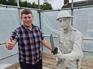 Councillor Simon Phipps with the Dudley War Memorial