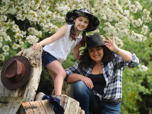 Vanessa Prince and daughter Monique, eight, prepare for the barn dance at St Dominic's Grammar School