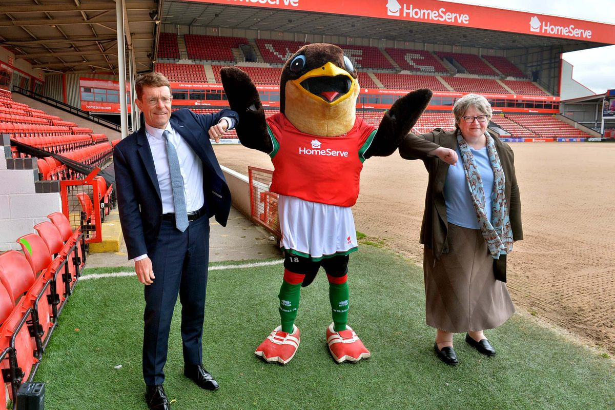 Mayor of the West Midlands Andy Street, Walsall FC mascot Swifty and Secretary of State for Work and Pensions Thérèse Coffey