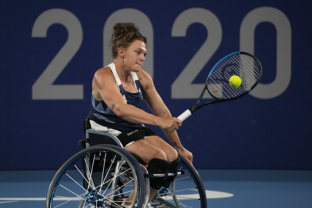 Britain's Jordanne Whiley competes against South Africa's Kgothatso Montjane and Mariska Venter during a women's doubles quarterfinal tennis match at the Tokyo 2020 Paralympic Games, Sunday, Aug. 29, 2021, in Tokyo, Japan. (AP Photo/Kiichiro Sato).