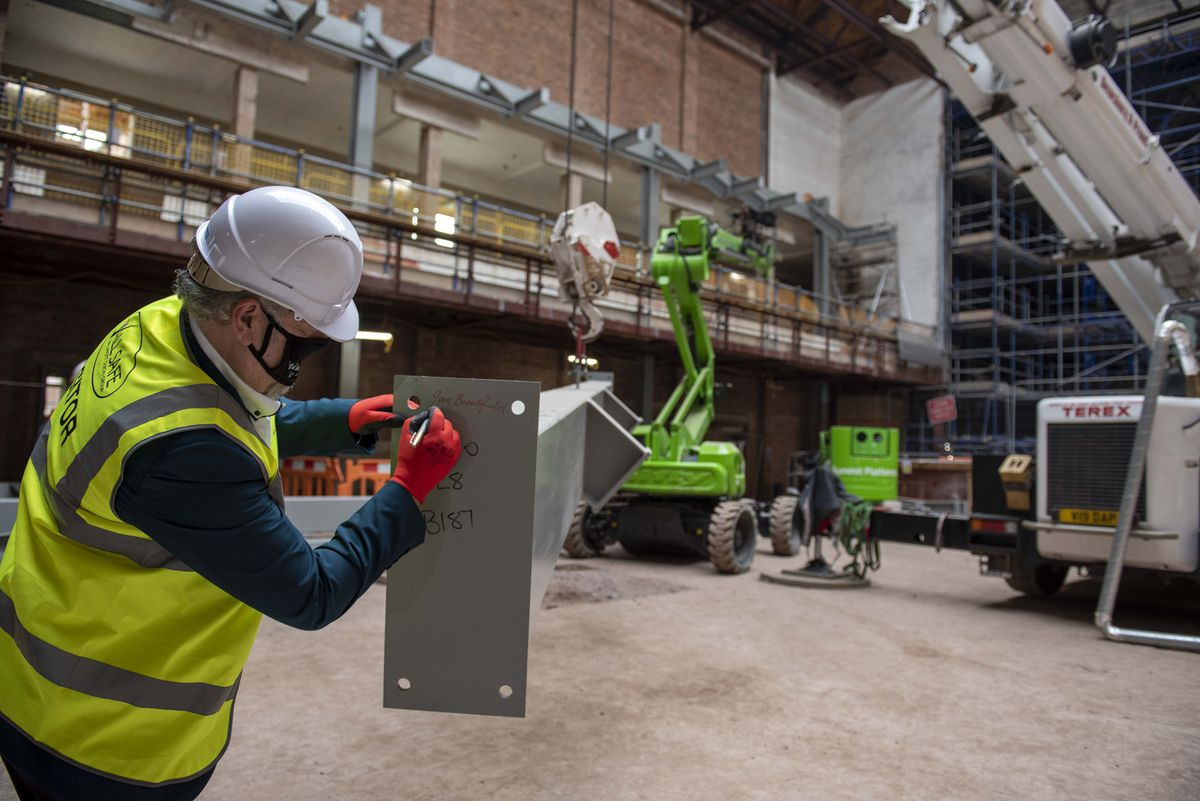 Council Leader Ian Brookfield signs one of the new steels at the Civic Halls