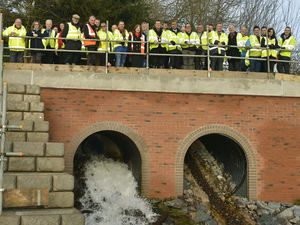 Guests celebrate the opening of the new flood defences