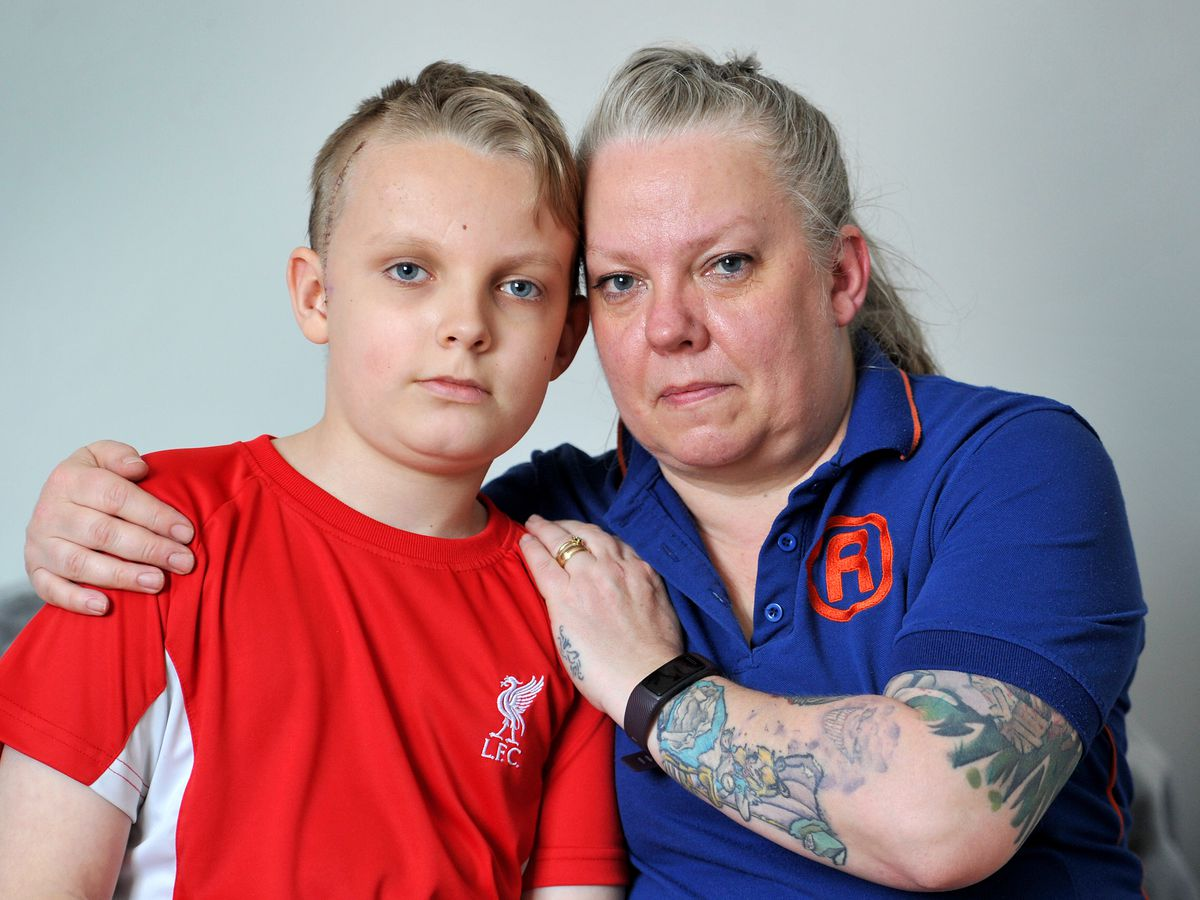 Archie Quilter, pictured with mum Helen, was hit by a car in May